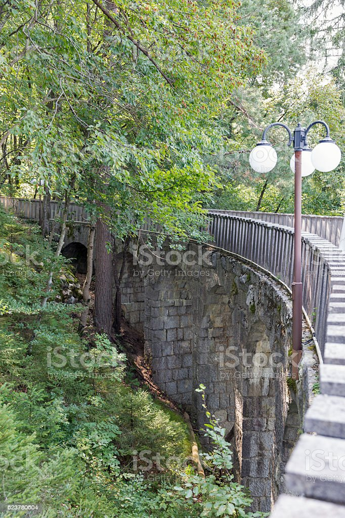 Stone bridge to Villa Bled upper terrace in Slovenia. stock photo