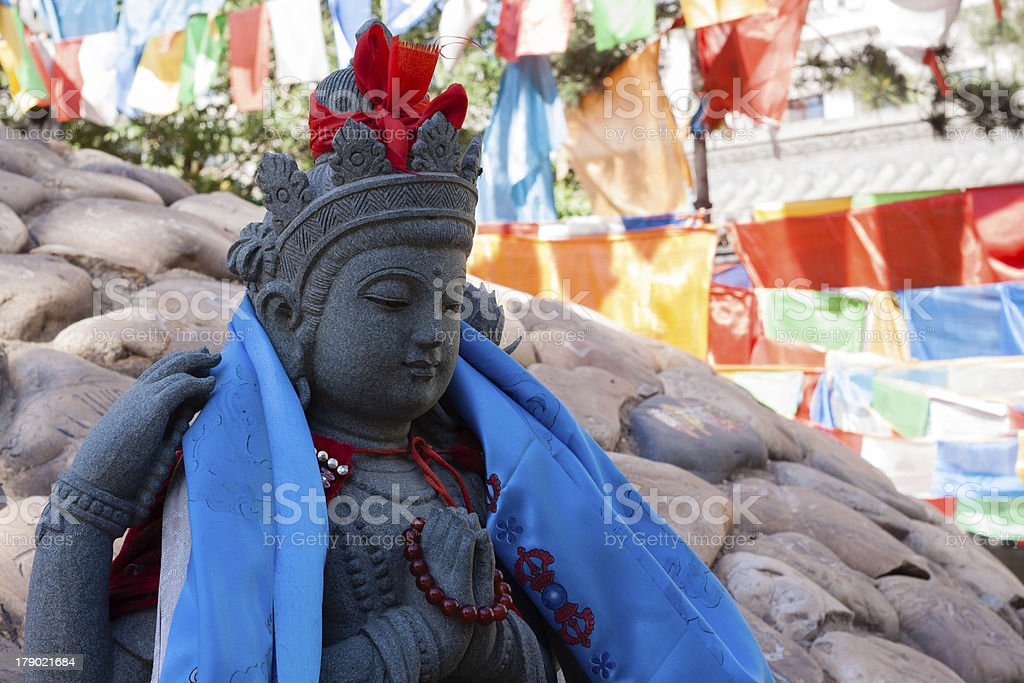 Stone Buddha in front of Mani Dui royalty-free stock photo