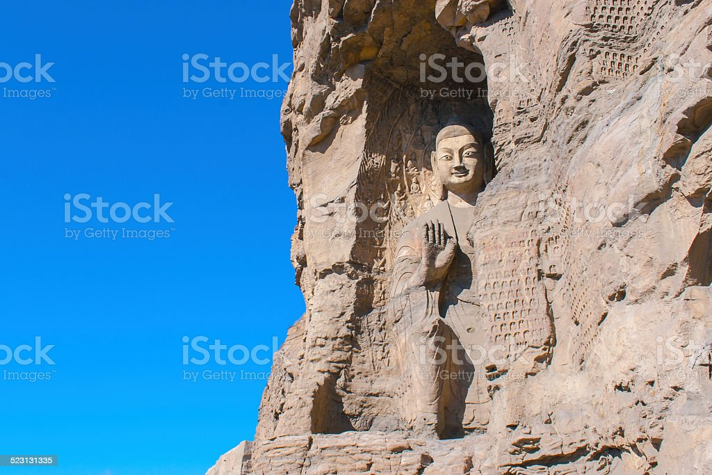 stone Buddha sculpture in the cave stock photo