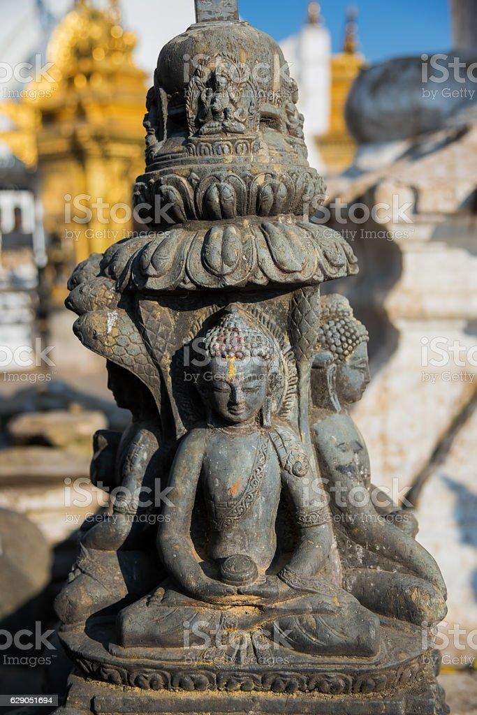 Stone buddha statue in Swayambhunath temple ,Kathmandu, Nepal. stock photo