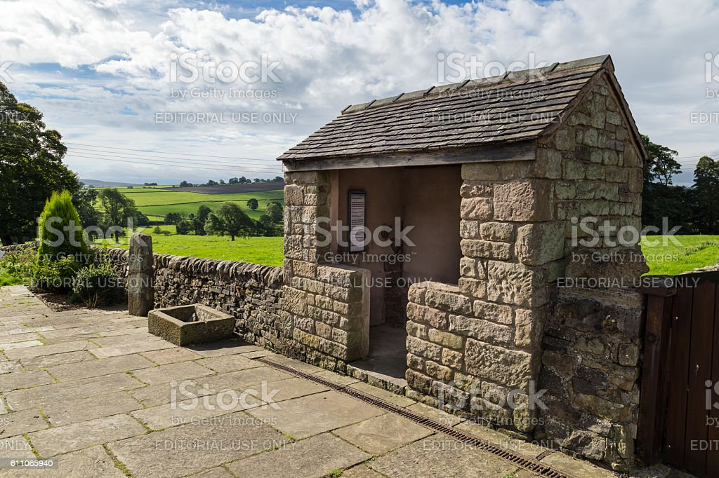 Stone bus shelter on Buxton Road, in Longnor stock photo