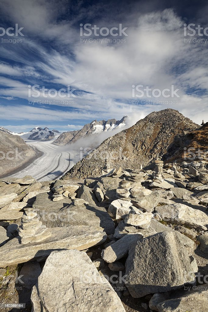 Stone cairn and Aletsch Glacier at Eggishorn, Switzerland royalty-free stock photo