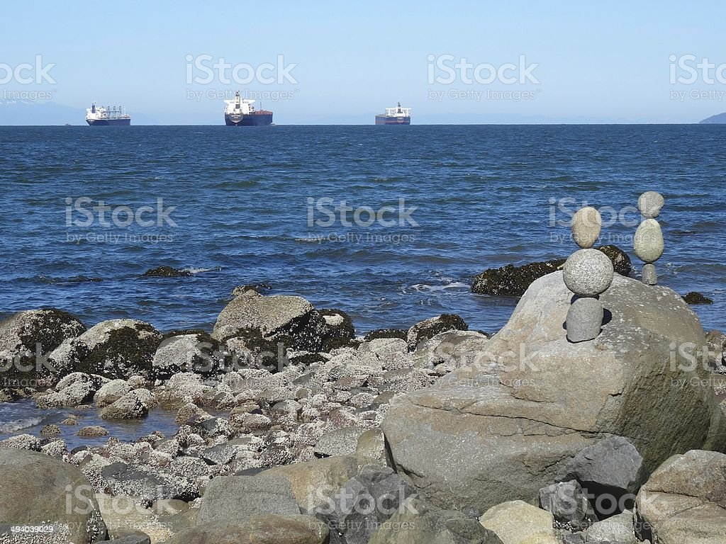 Stone Cairns and the ocean, Stanley Park, Vancouver royalty-free stock photo