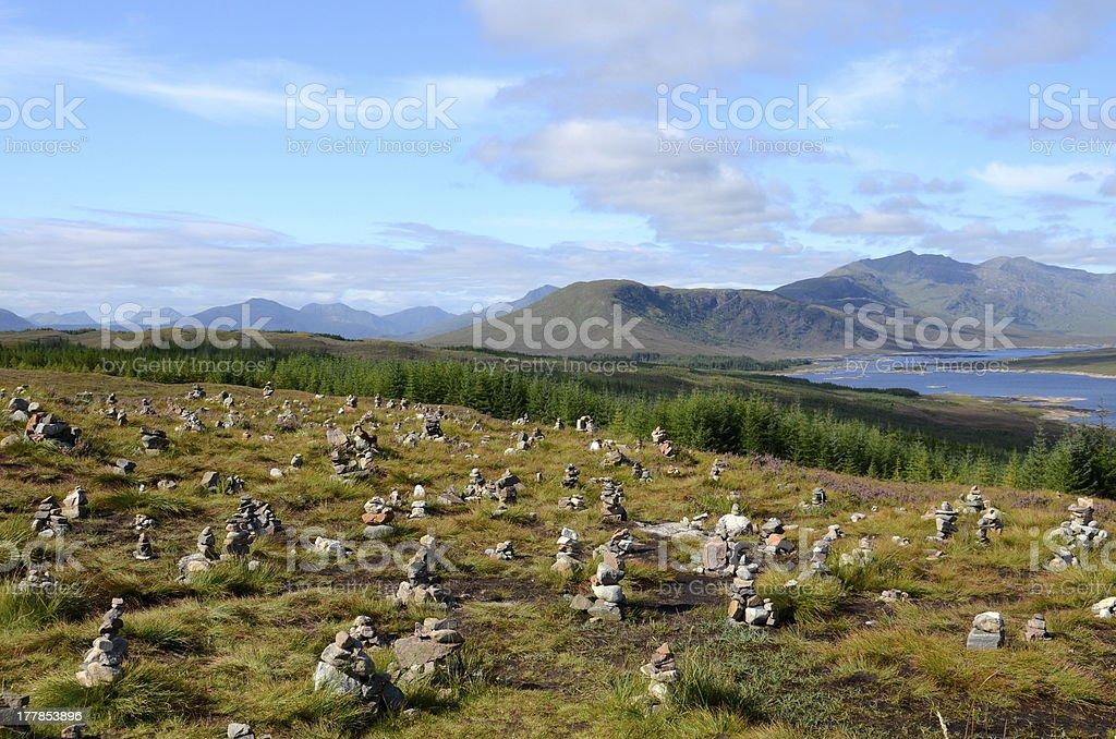 Stone cairns, Loch Loyne, Scotland stock photo