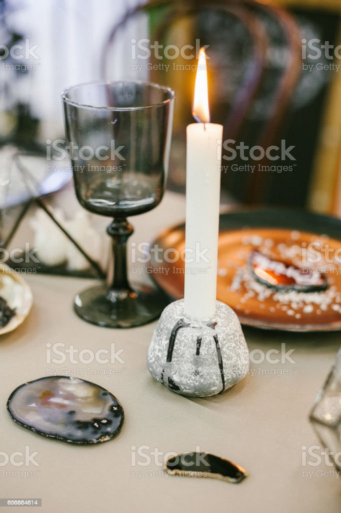 Stone candlestick with candle, glass. stock photo