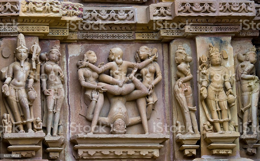 Stone carved  relief in Hindu temple in Khajuraho, stock photo