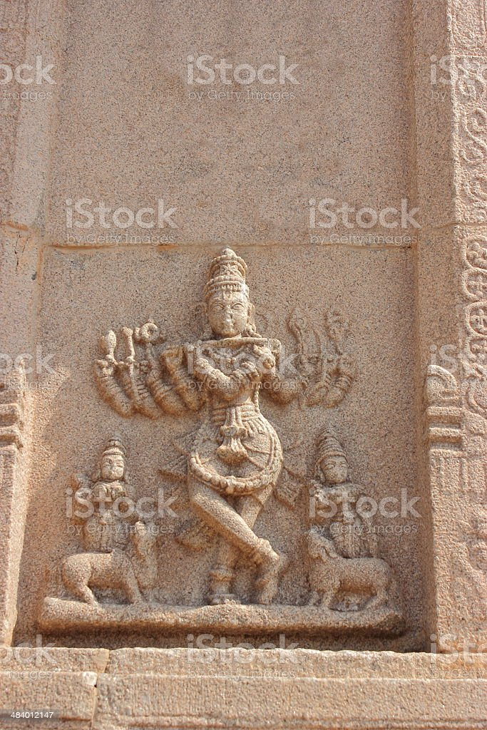 Stone carved sculpture of Hindu god Krishna in Hampi royalty-free stock photo