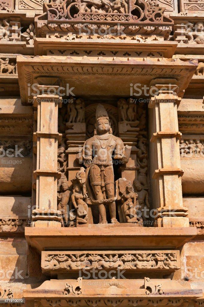 Stone carved sculpture of Male Deity on Lakshmana temple. Khajuraho stock photo
