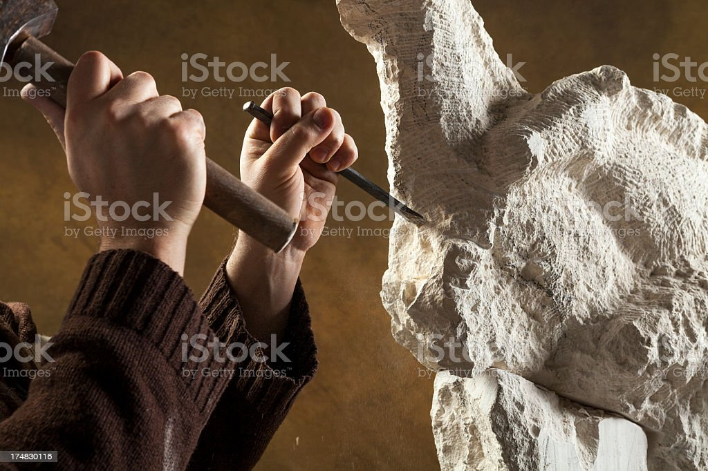 Stone carver working on a piece royalty-free stock photo