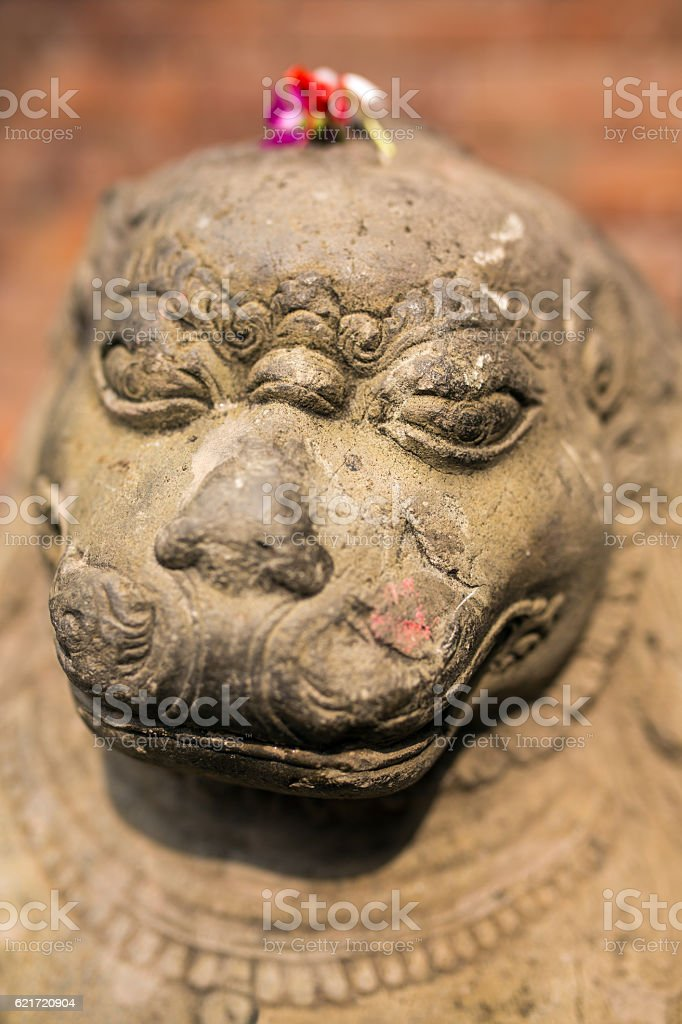 Stone carving of a lion at Bhaktapur Durbar square, Nepal stock photo
