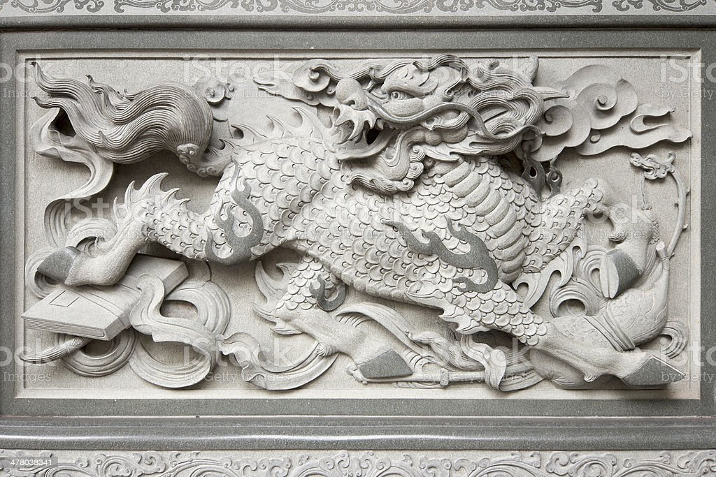 Stone Carving of Qilin on Chinese Temple Wall royalty-free stock photo