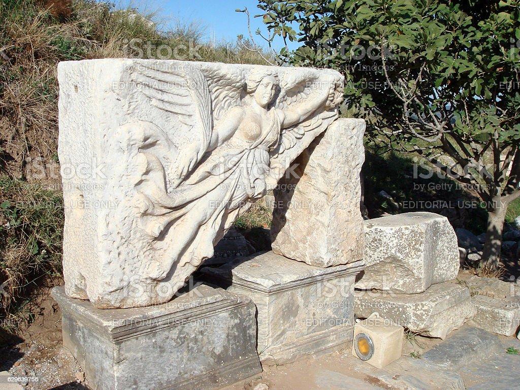 Stone Carving of the Greek Goddess Nike stock photo