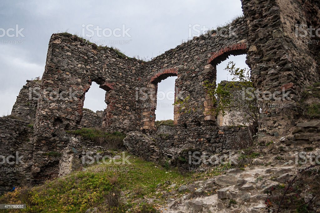 stone castle ruins surrounded by grass royalty-free stock photo