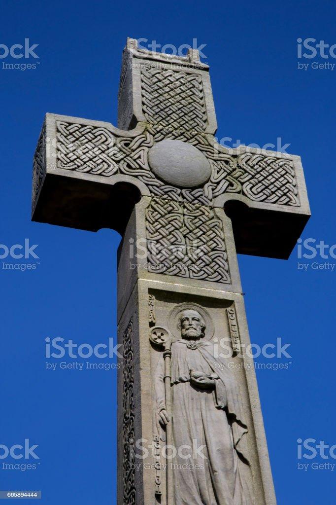 Stone Celtic Cross Against a Blue Sky stock photo