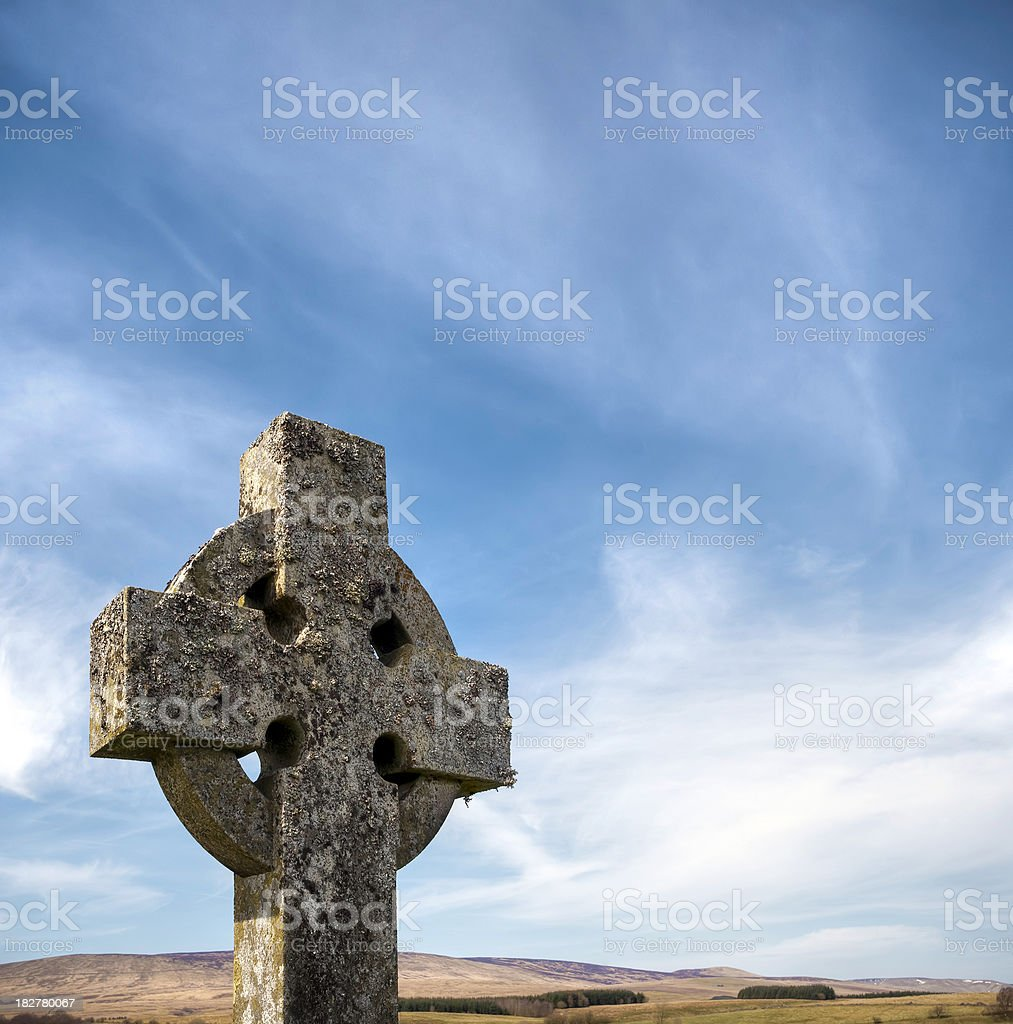 Stone celtic cross with blue sky royalty-free stock photo