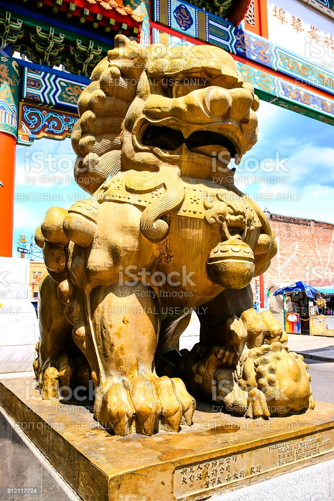 Stone Chinese Foo dog gate guardian in Portland OR stock photo