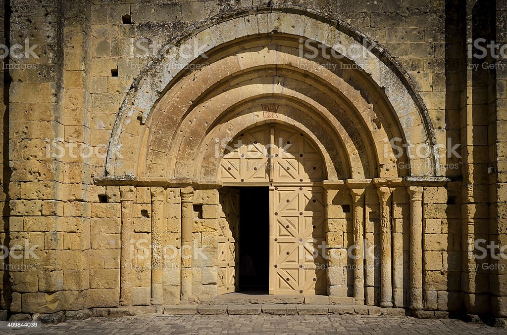 Stone church entrance door and arcs stock photo
