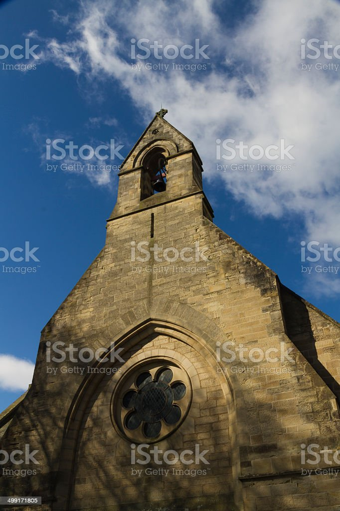 Stone church with open bell tower stock photo