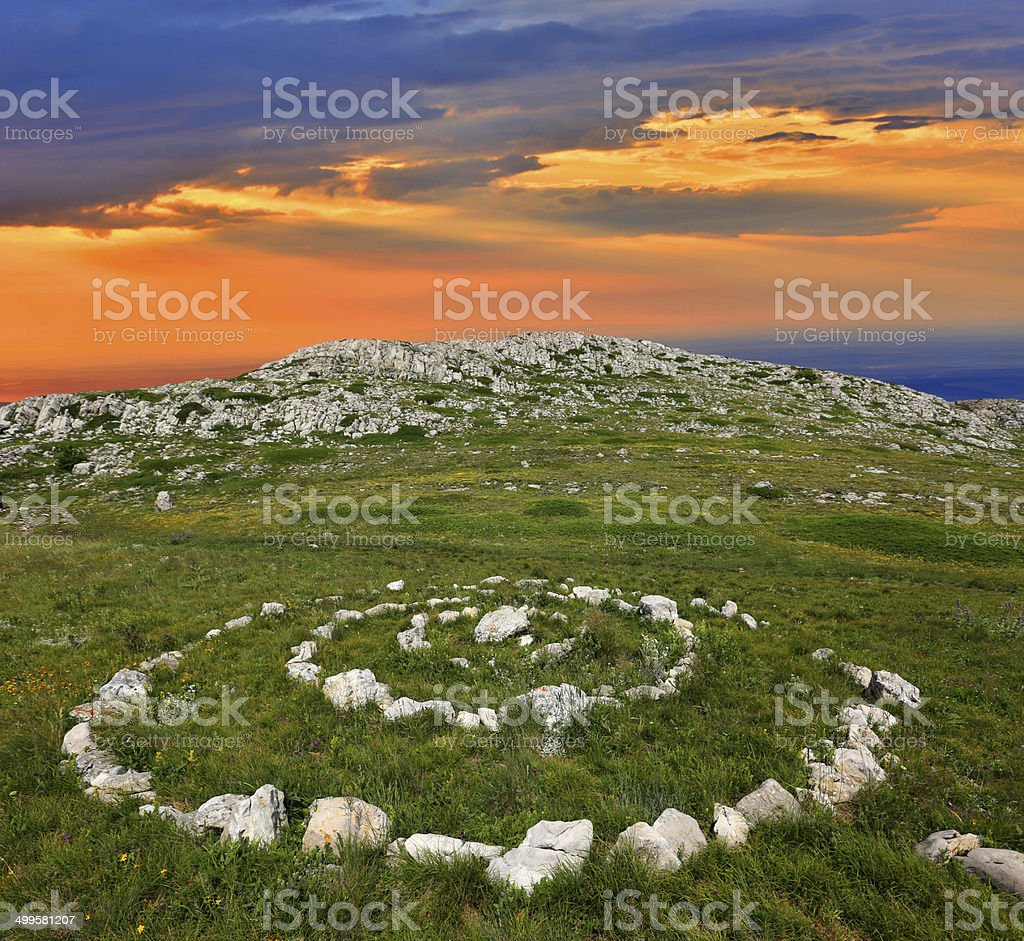 stone circles in mountains stock photo