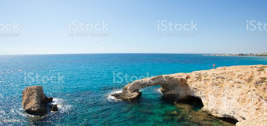 Stone cliff in a beautiful blue sea Cyprus stock photo
