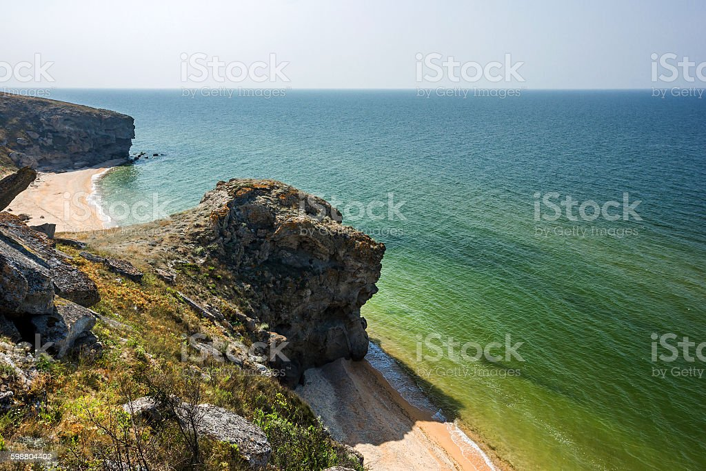stone cliffs on the coast and blue sky stock photo