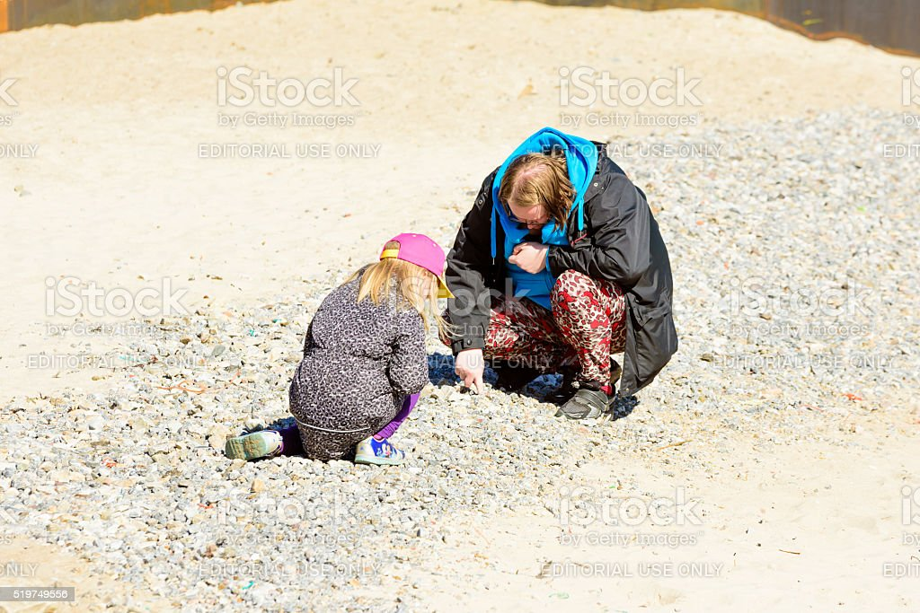 Stone collecting stock photo
