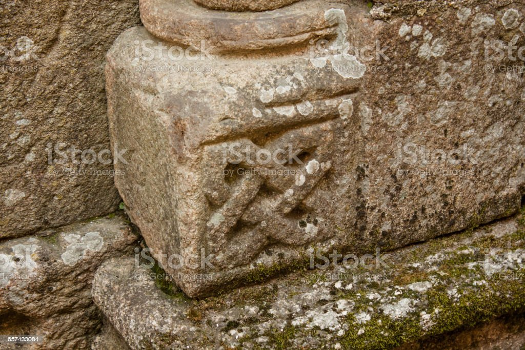 stone column base with celtic style prints from a medieval romanesque church in Galicia Spain stock photo