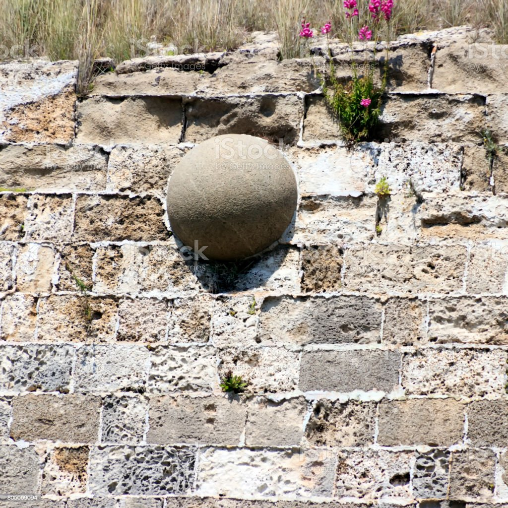 Stone core stuck in the wall stock photo