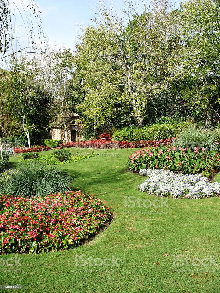 Stone Cottage in Formal Gardens royalty-free stock photo