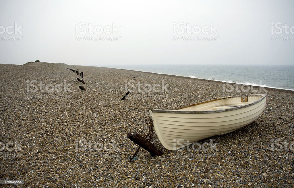 Stone covered beach in Norfolk royalty-free stock photo