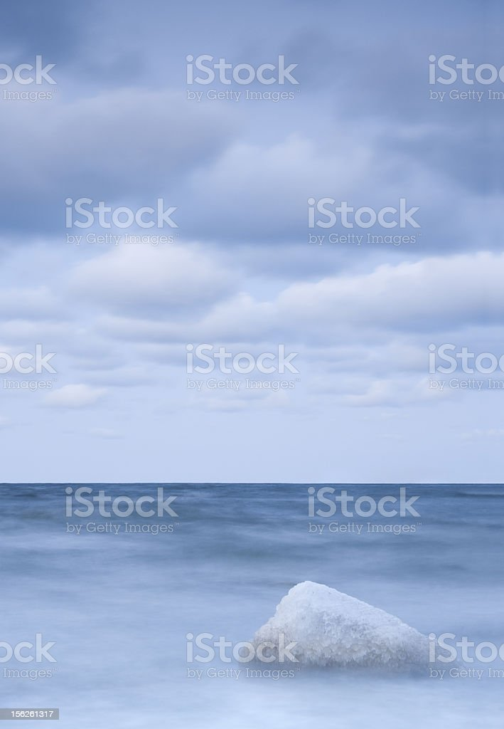 Stone covered with ice in sea at night royalty-free stock photo