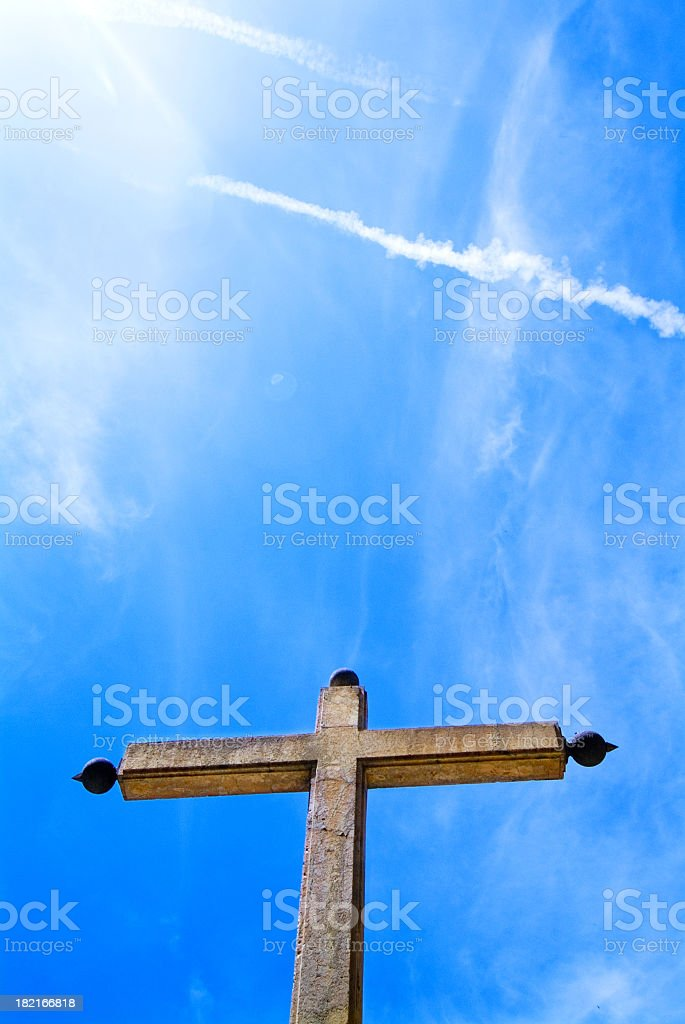 Stone cross against blue sky royalty-free stock photo
