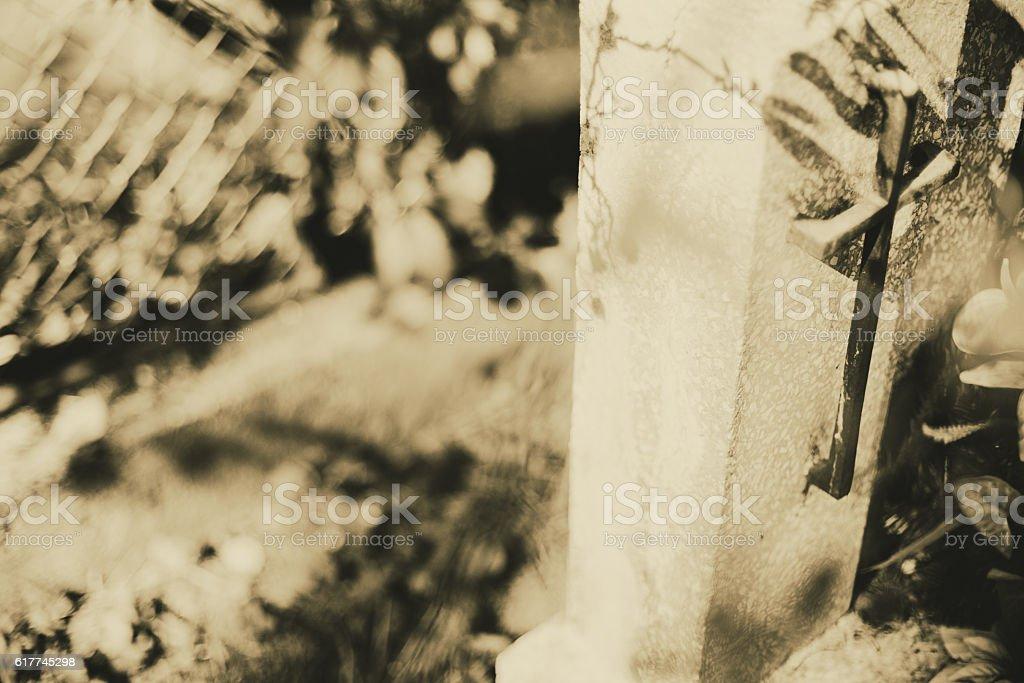 Stone cross on the cementery stock photo