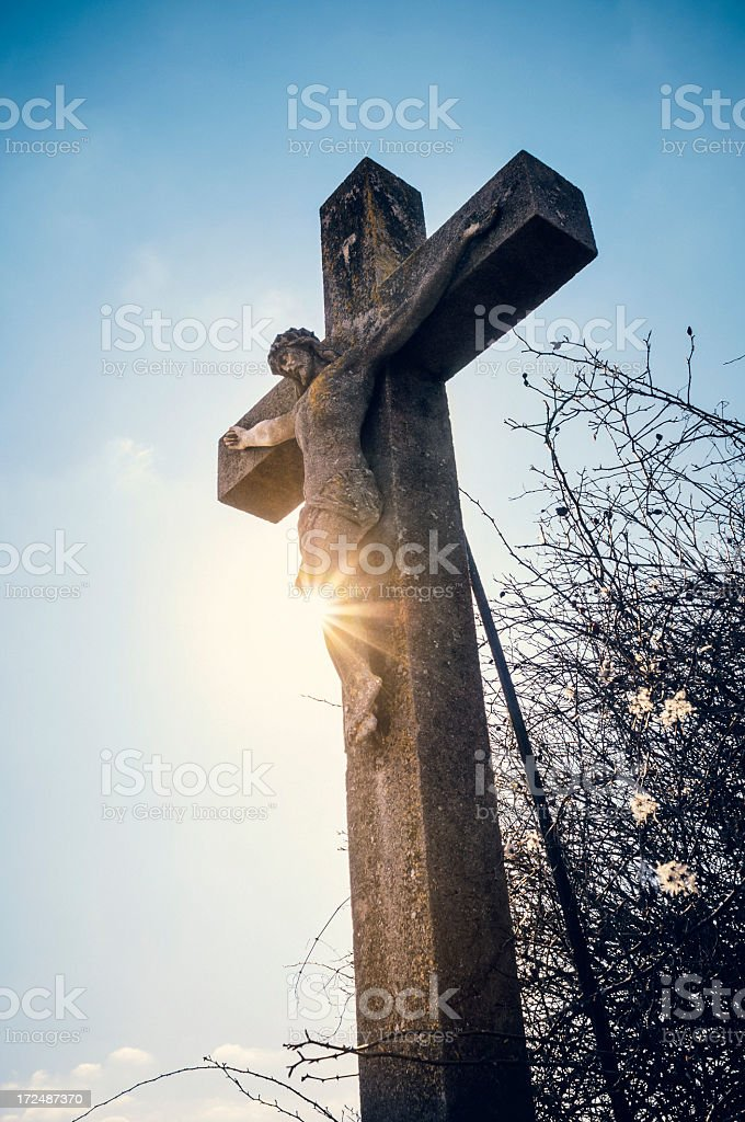 Stone crucifix with sun royalty-free stock photo
