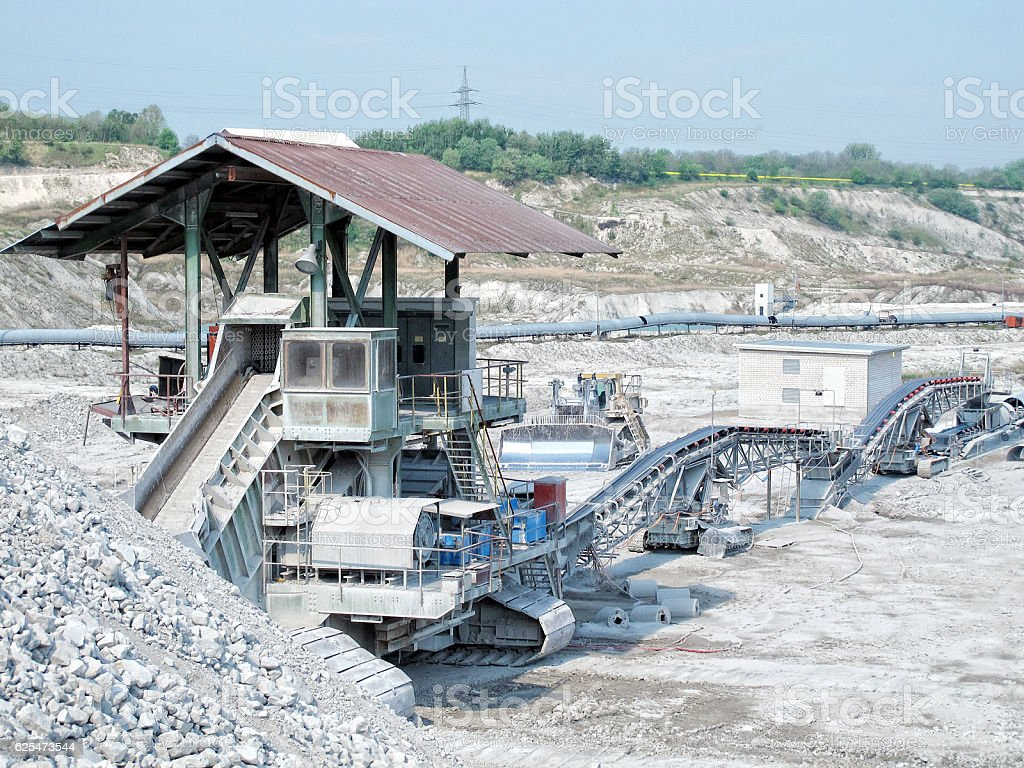stone crusher in an open pit mine of chalk rocks. stock photo
