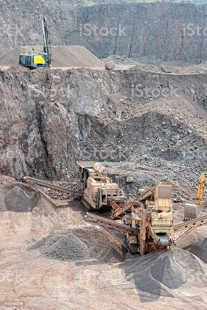 stone crusher in an open pit mine of porphyry rocks. stock photo