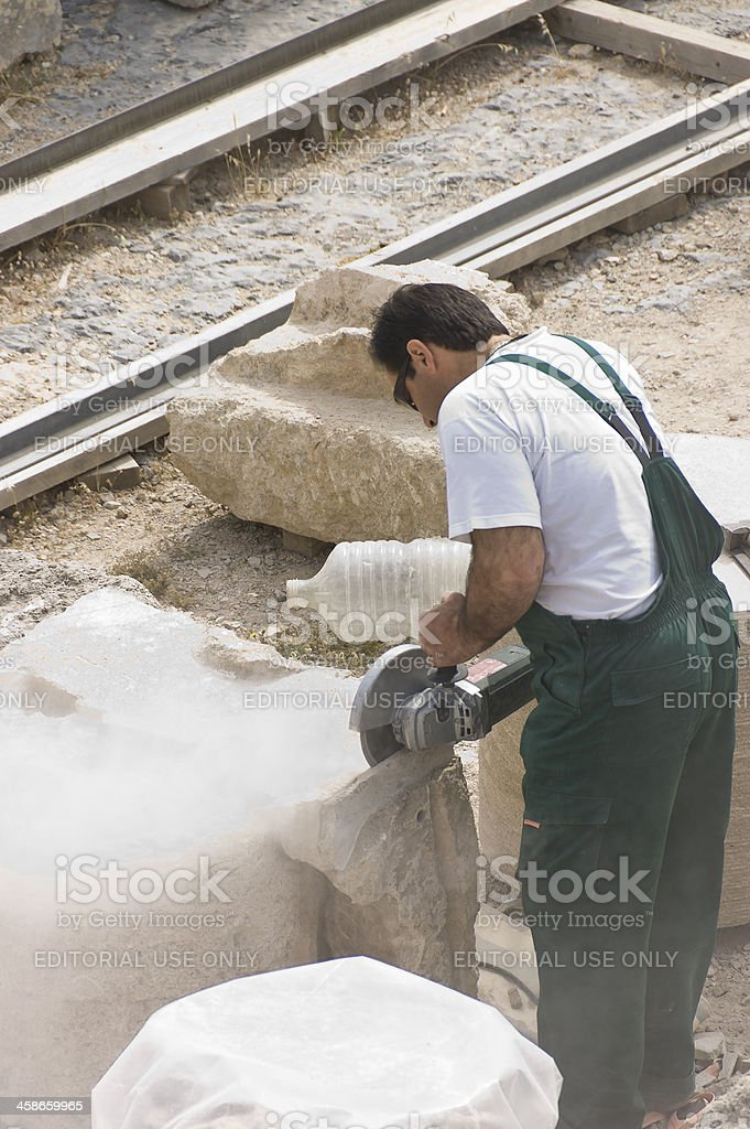 stone cutter worker stock photo