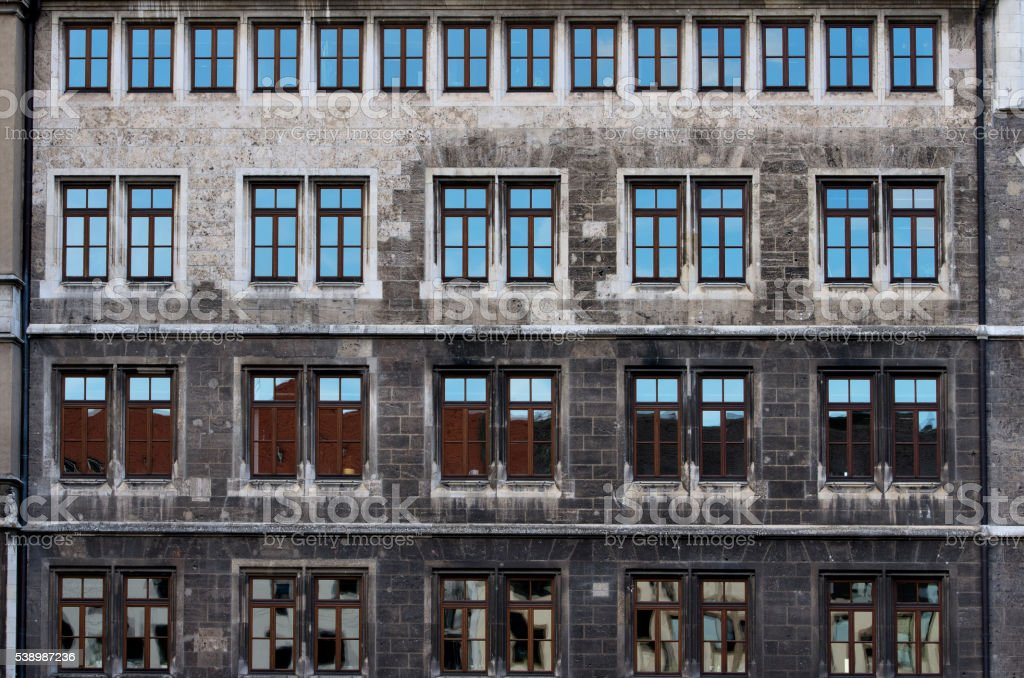 Stone facade with rows of windows royalty-free stock photo
