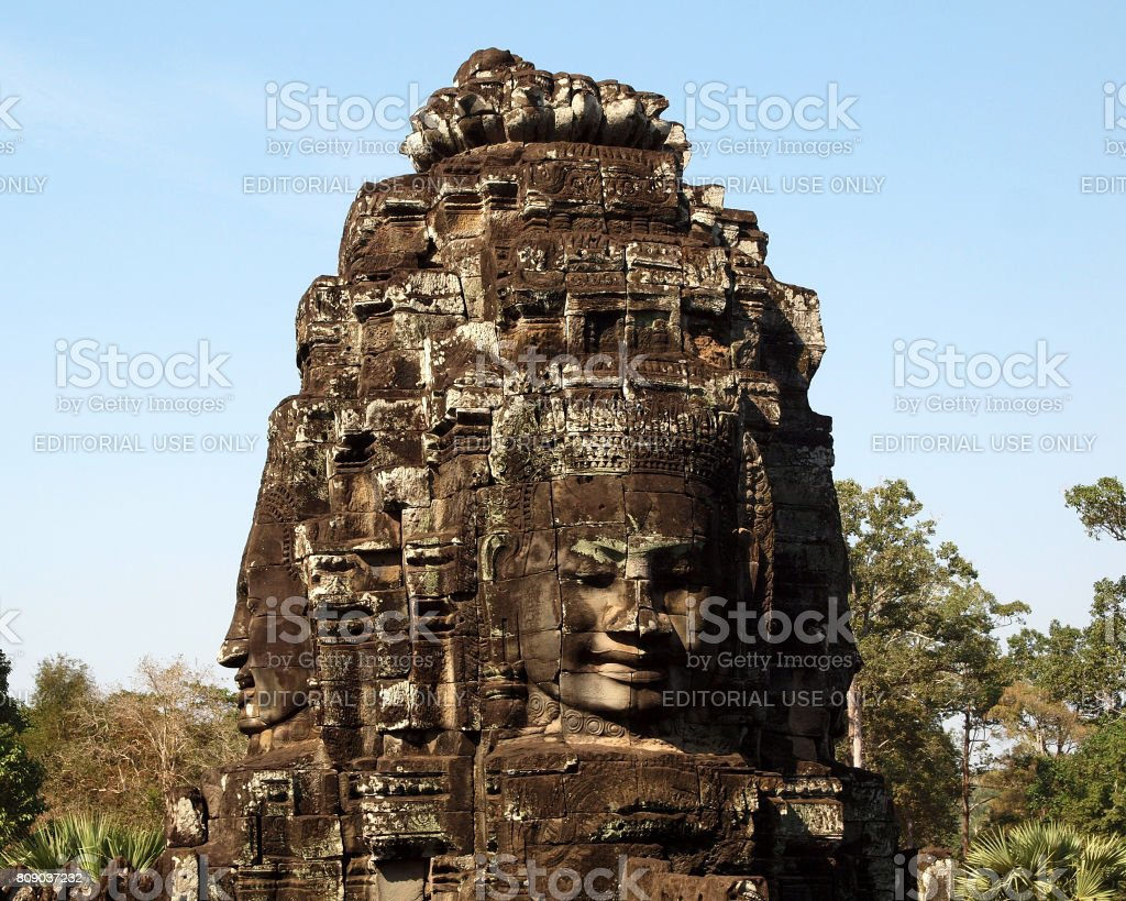 Stone face tower at the Bayon Temple stock photo