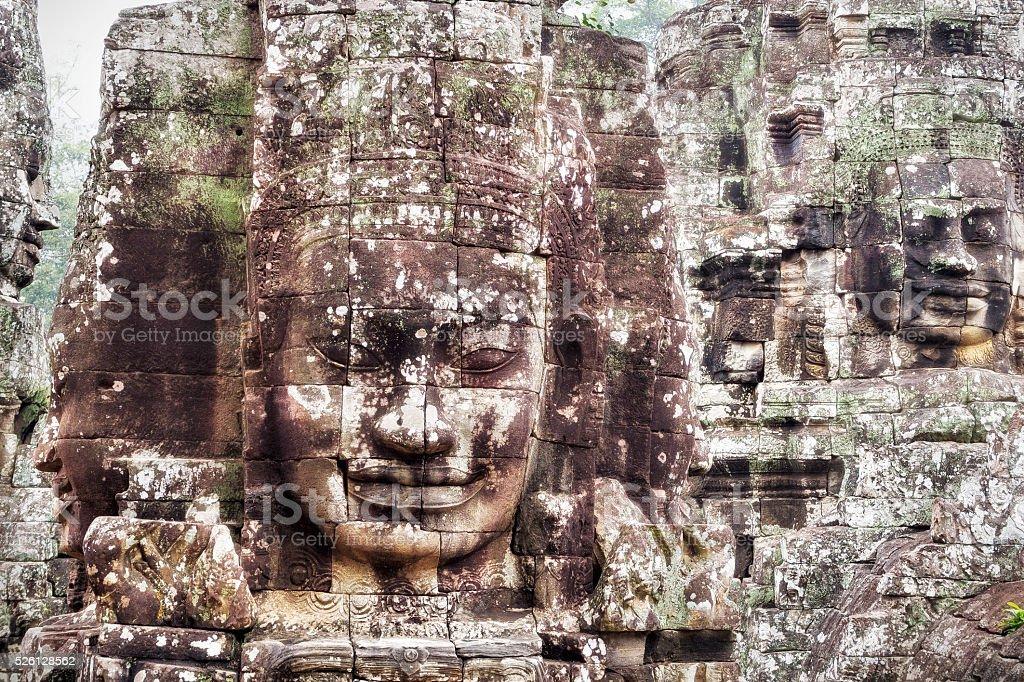 Stone Faces at Bayon Temple at Angkor, Siem Reap, Cambodia stock photo