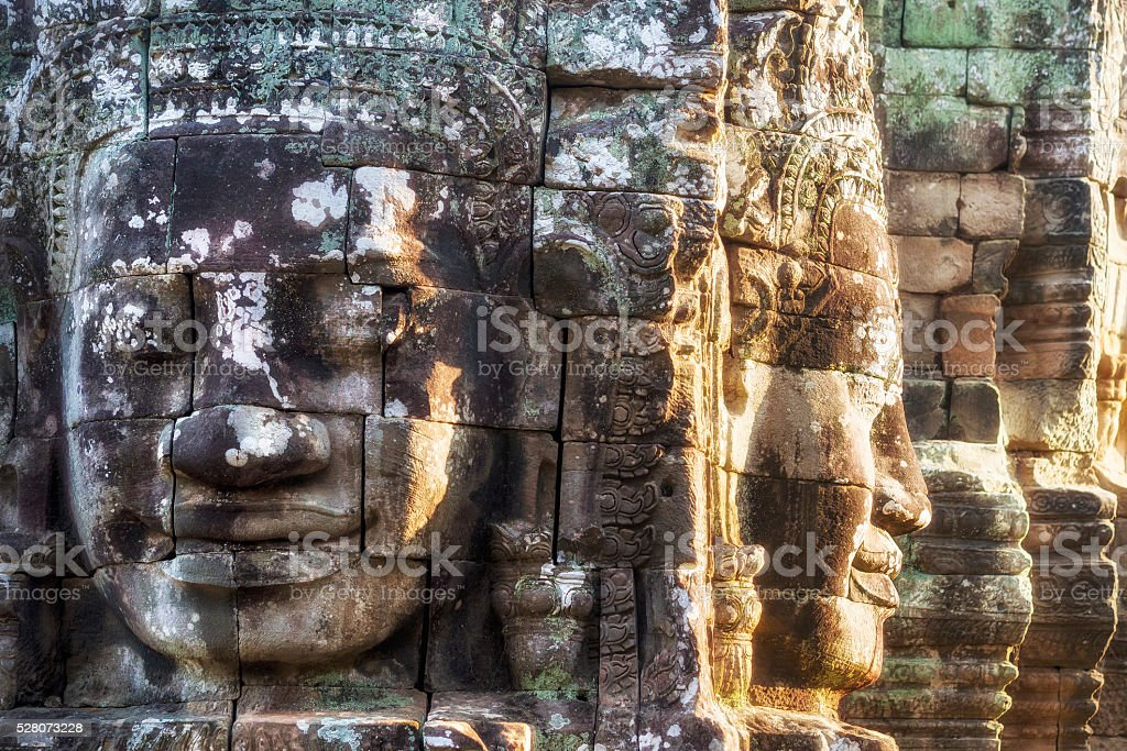 Stone Faces at Bayon Temple at Angkor, Siem Reap, Cambodia stock photo