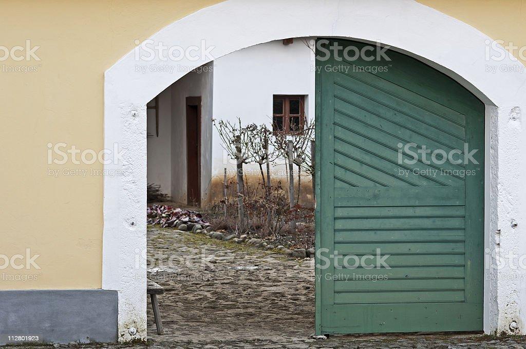 Stone farmhouse's gate stock photo