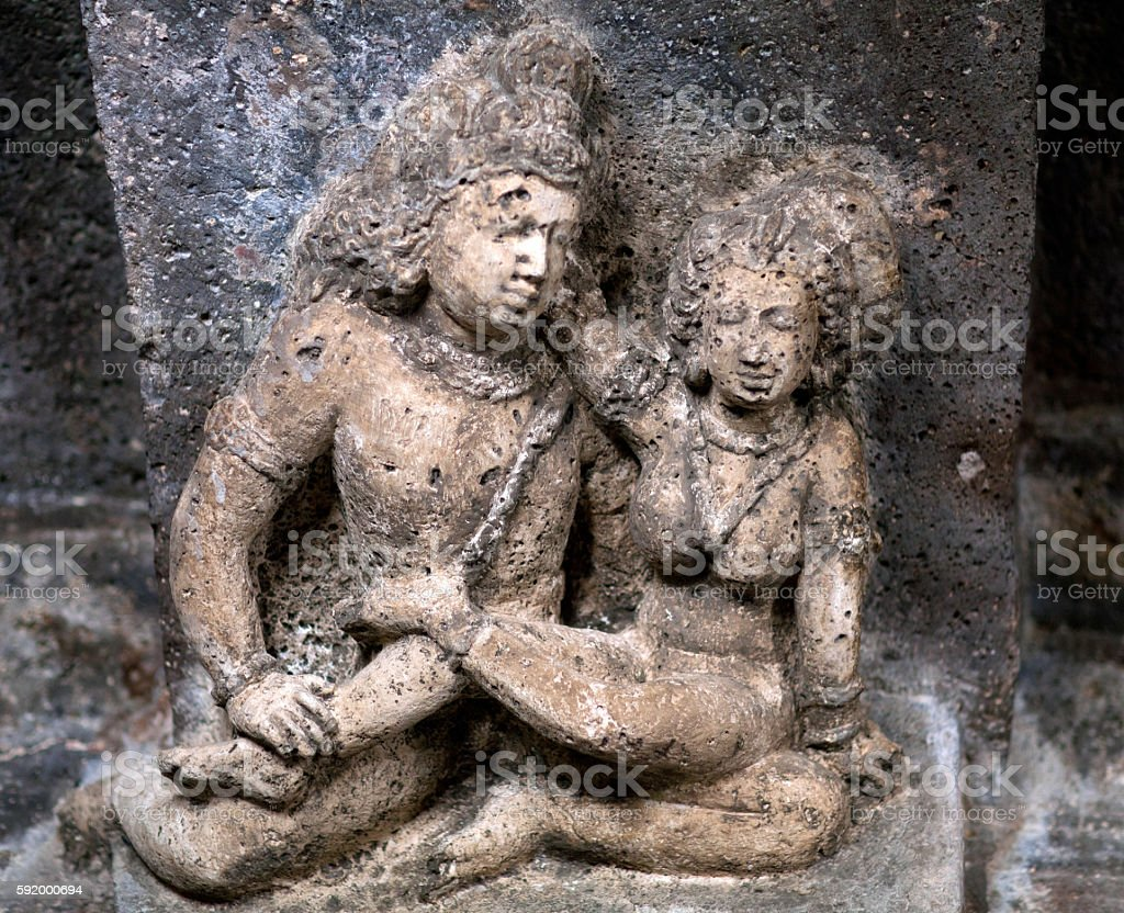 Stone figure of lovers in Ajanta caves, India stock photo