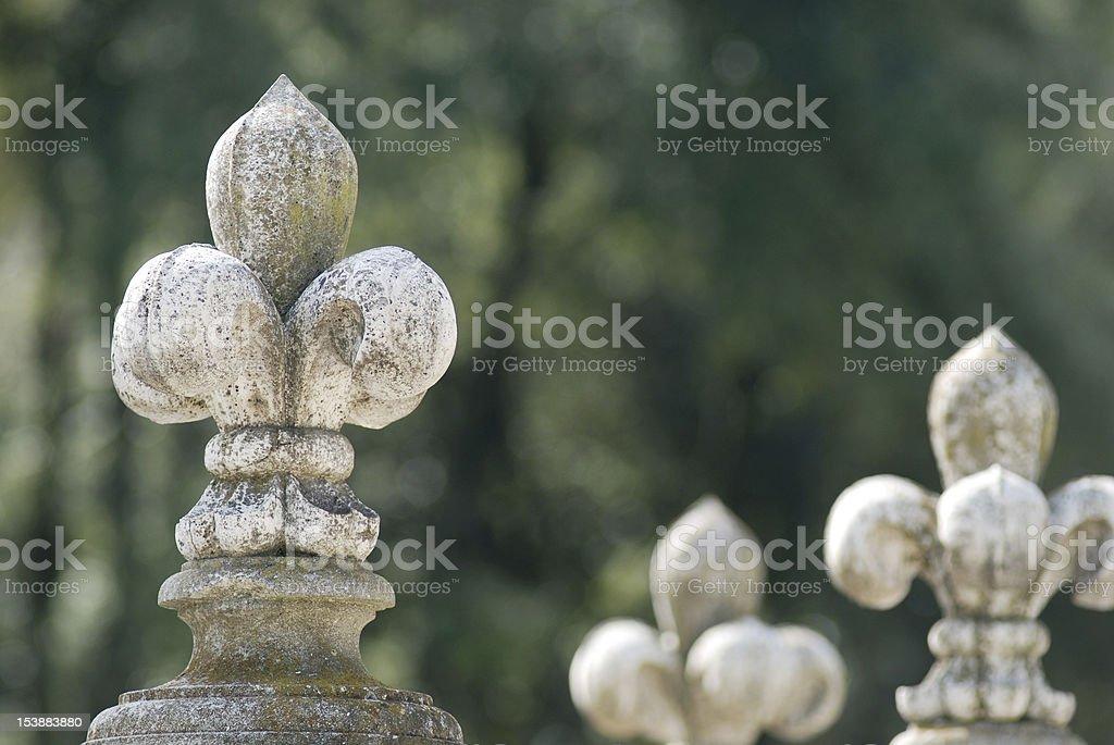 Stone fleur-de-lys stock photo