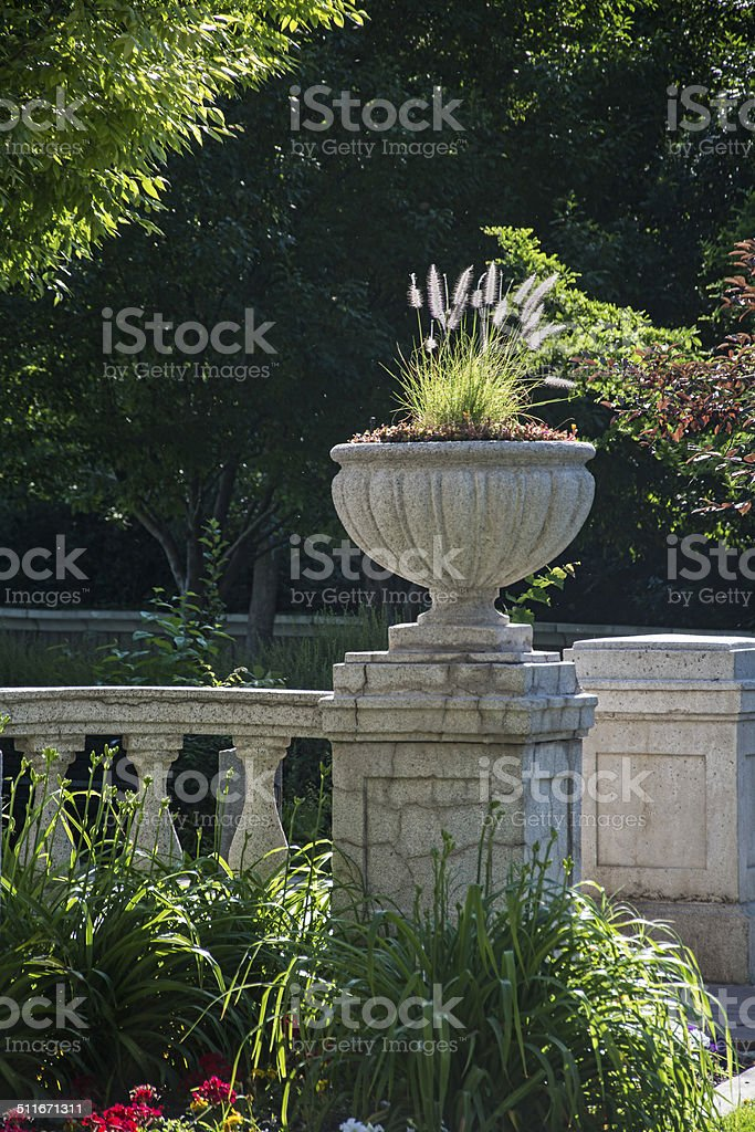 Stone Flower Vase and greenery stock photo