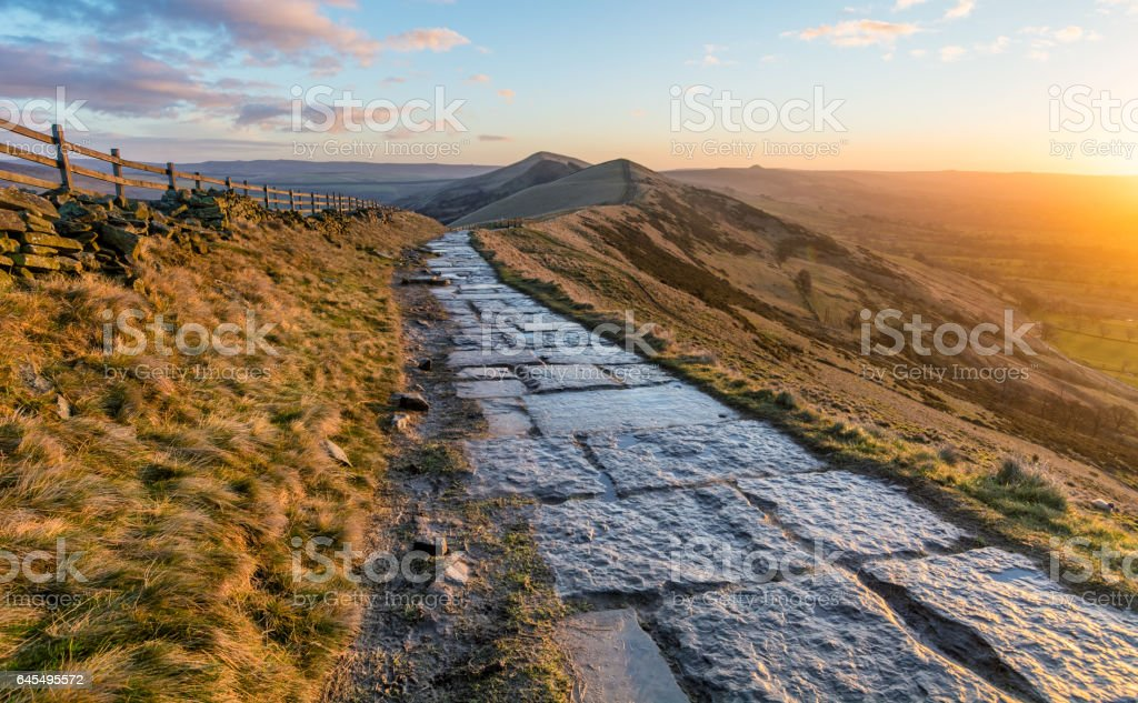 Stone Footpath With Beautiful Vibrant Sunrise. stock photo