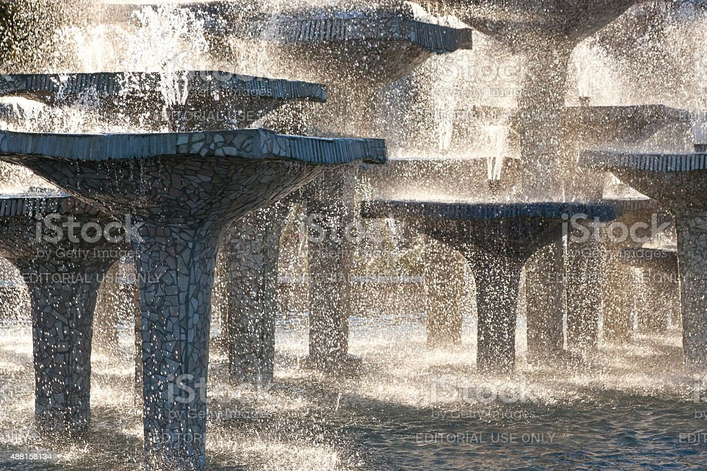 stone fountain with dripping water stock photo