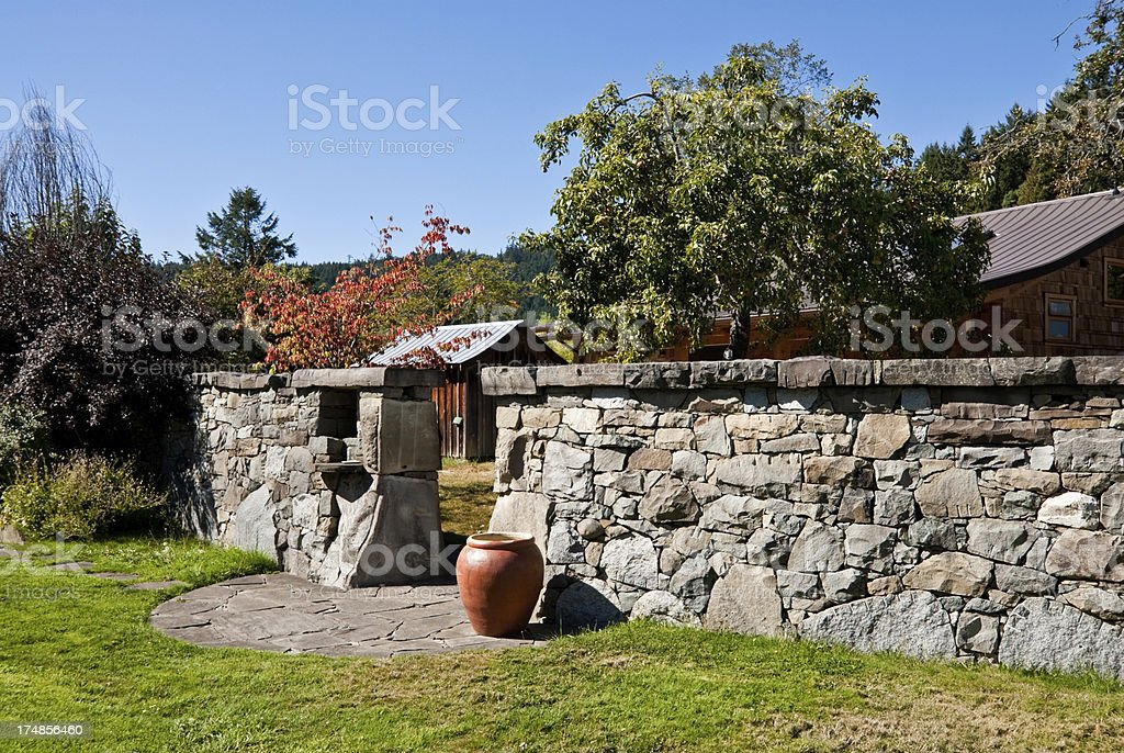 Stone Garden Wall and Urn stock photo