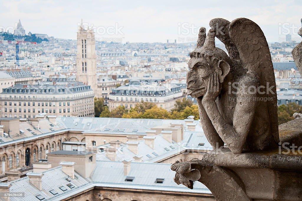 Stone Gargoyle (Chimera), Notre Dame Cathedral, overlooking city of Paris stock photo