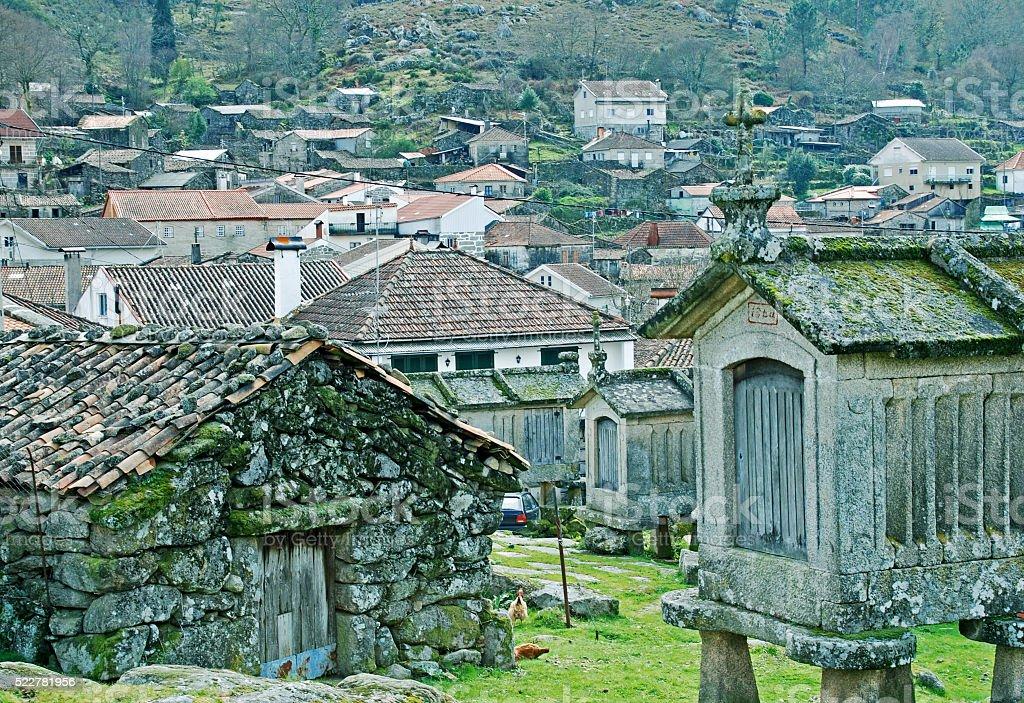 Stone granaries in old village of Lindoso Portugal stock photo